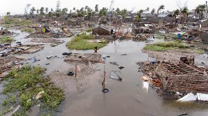 In this photo taken on Friday, March 15, 2019 and provided by the International Red Cross, an aerial view of the destruction of homes after Tropical Cyclone Idai, in Beira, Mozambique. Mozambique's President Filipe Nyusi says that more than 1,000 may have by killed by Cyclone Idai, which many say is the worst in more than 20 years. Speaking to state Radio Mozambique, Nyusi said Monday, March 18 that although the official death count is currently 84, he believes the toll will be more than 1,000. (Denis Onyodi/IFRC via AP)